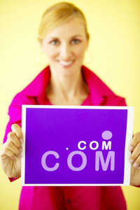 lady holding dot com sign